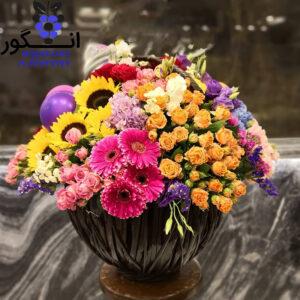 گلدان گلهای رنگین کمانی
